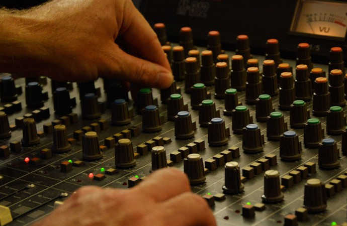 mixing audio on a mixing desk