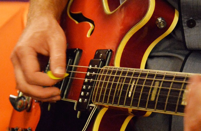 Playing an Epiphone guitar