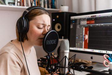 Singer recording vocals in a home studio